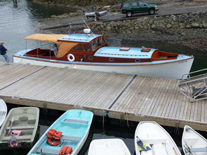 Man bring in classic powerboat