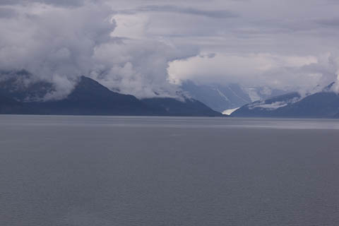 Long view of water, mountains, and tidewater glacier.