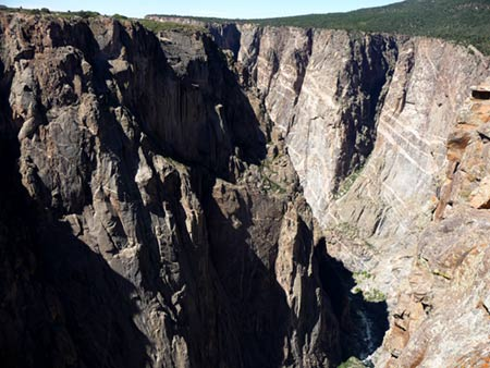 Painted wall of Black Canyon of the Gunnison from North Rim with Gunnison River at bottom