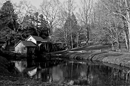 Black and White photo of Mabry Mill in late fall after leaves have fallen