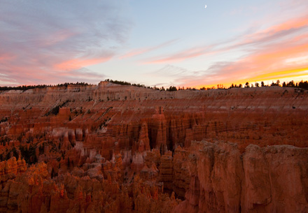 Bryce Canyon Sunset red rocks with new moon