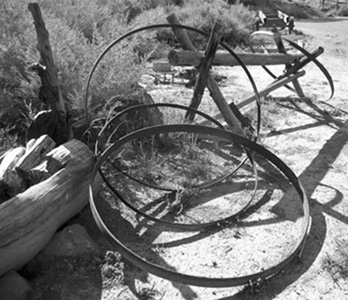 Black  and white photo of iron wheel rims