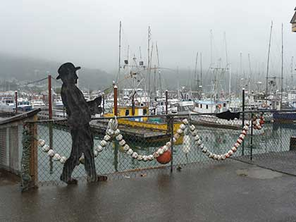 Cutout of fisherman overlooking boats