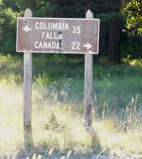 Sign showing 22 miles to Canada