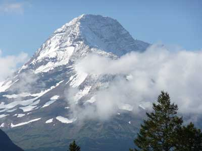 Photo of snow covered peak in Glacier