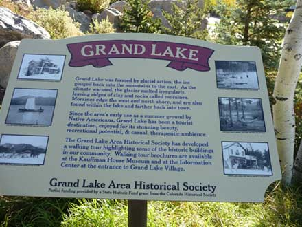 Sign about how the Grand Lake was formed.Grand Lake was formed by glacial action the ice gouged back into the mountains to the east.
