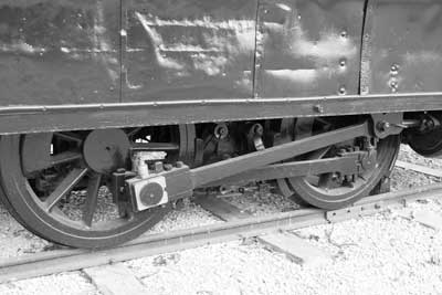 Black and white of train engine wheels