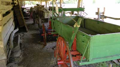 Green wooden wagon with red wheel
