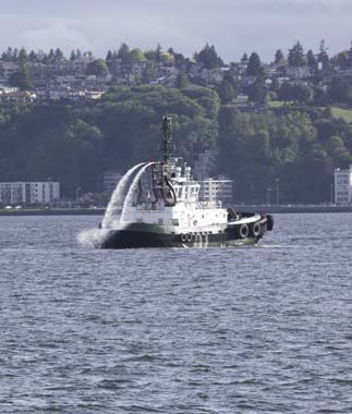 Tugboat starting to spray water
