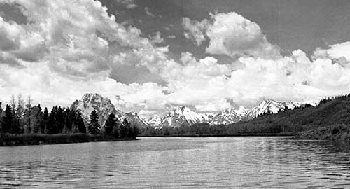 Black and White photo of Yellowstone river with snow covered mountains in background