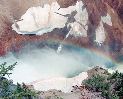 Yellowstone Falls with snow and rainbow