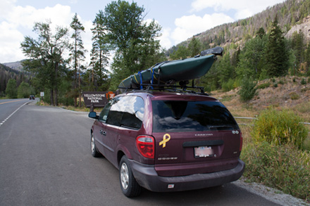 Nessie and Minivan with Yellowstone Park Sign